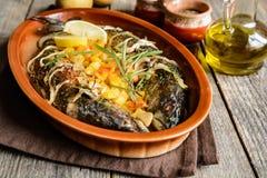 Roasted mackerel with vegetable garnish Stock Photo