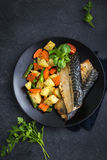 Roasted mackerel and vegetables Royalty Free Stock Photos