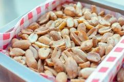 Roasted marinated peanuts. Roasted delicious marinated peanuts closeup Royalty Free Stock Images