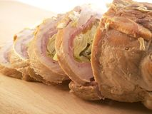 Roasted meat. With bacon and artichokes royalty free stock photo