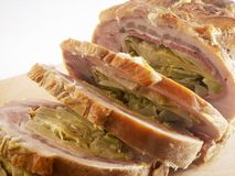 Roasted meat. With bacon and artichokes royalty free stock photography