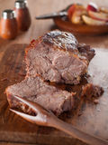 Roasted meat. With apple, selective focus Stock Image