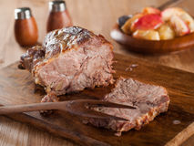 Roasted meat. With apple, selective focus Stock Photo