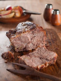 Roasted meat. With apple, selective focus Royalty Free Stock Photo