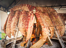 Roasted meat of beef cooked on a vertical grills. stock photography