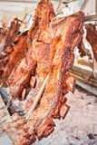 Roasted meat of beef cooking. Asado is traditional Argentine dis Stock Photo