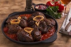 Roasted meat on the bone Osso Buco in tomato sauce Stock Photos
