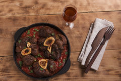 Roasted meat on the bone Osso Buco in tomato sauce Royalty Free Stock Images