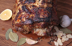 Roasted meat on a cutting board. Royalty Free Stock Images