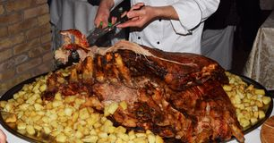 Roasted meat while cutting it Stock Image