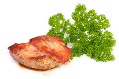 Roasted meat with greens. White background Stock Image