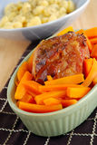 Roasted  meat joint. With batton carrots Stock Images