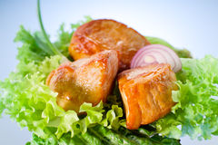 Roasted meat on lettuce leaves Royalty Free Stock Image
