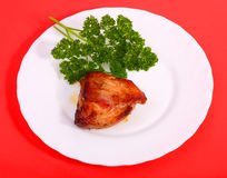 Roasted meat on a plate(Red background). Roasted meat with vegetables on a white plate. Red background Stock Images