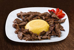 Roasted meat with polenta Stock Photography