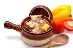 Roasted meat in pot and vegetables Stock Photo
