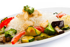 Roasted meat, rice noodles and vegetables on white Stock Images