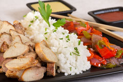 Roasted meat with rice and vegetables. Roasted meat with rice and fried vegetables Stock Photo