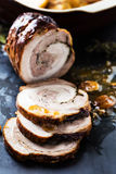 Roasted meat roll stuffed with herbs Stock Photography
