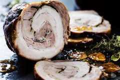 Roasted meat roll stuffed with herbs Stock Photos