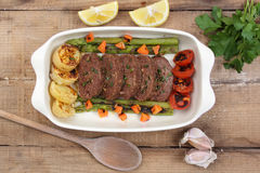 Roasted meat roll with vegetables Stock Photos