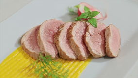 Roasted meat served. On a plate, close-up shoot stock footage