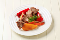 Roasted meat on skewer and baked vegetable Stock Photography