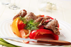 Roasted meat on skewer and baked vegetable Royalty Free Stock Photos