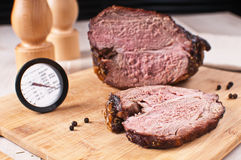 Roasted meat slice and thermometer stock photos