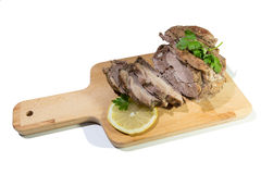 Roasted meat sliced on the board. Stock Images