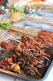 Roasted meat on the sticks Royalty Free Stock Images