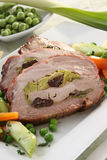 Roasted meat stuffed with vegetables Stock Photo