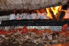 Roasted meat - Turkish doner kebab. Doner kebab on it's special bbq set with tray of sliced meat seen from above Stock Image