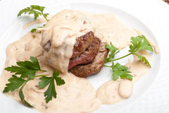 Roasted meat under white sauce Stock Photography