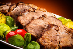Roasted meat and vegetables Stock Images