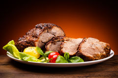 Roasted meat and vegetables Royalty Free Stock Images