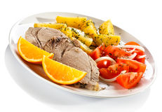 Roasted meat and vegetables Stock Image
