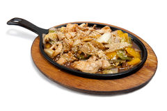 Roasted meat with vegetables on frying pan Royalty Free Stock Photos
