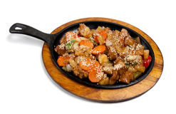Roasted meat with vegetables on frying pan Royalty Free Stock Image