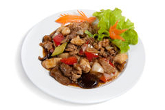 Roasted meat with vegetables on a plate Stock Images