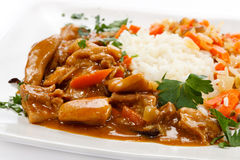 Roasted meat, white rice and vegetables Stock Photography