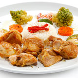 Roasted meat, white rice and vegetables Stock Photos