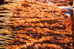 Roasted meat on wood sticks Stock Photo