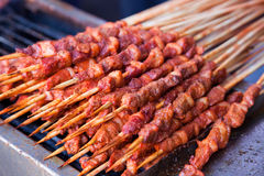 Roasted meat on wood sticks Royalty Free Stock Photography