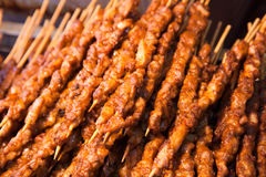 Roasted meat on wood sticks Royalty Free Stock Image