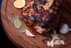 Roasted meat on wooden cutting board closeup Royalty Free Stock Images