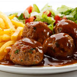 Roasted meatballs with chips Royalty Free Stock Photo