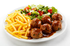 Roasted meatballs with chips Royalty Free Stock Photography