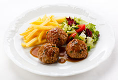 Roasted meatballs with chips Royalty Free Stock Photos