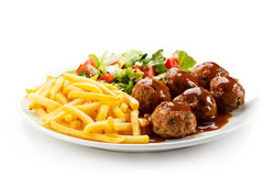 Roasted meatballs and French fries Stock Photography